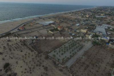 ارض طابو ع شاطئ بحر خانيونس