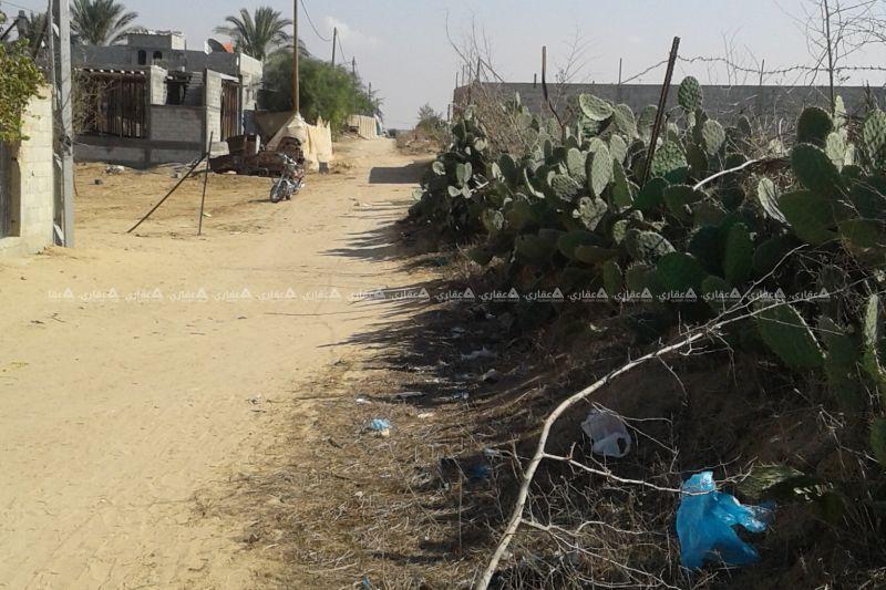 ارض غرب الشارع الدولى بالقرارة شرق مقبرة الشيخ حموده مباشرة طابو