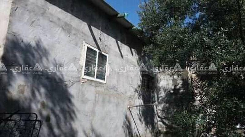 قطعه أرض مبني عليها منزل