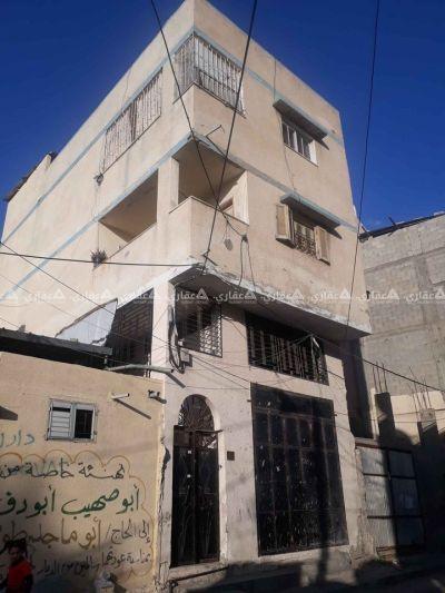 عمارة بالقرب من مسجد الشمعة